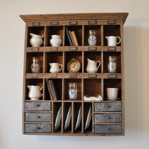 Retro cubbies in warm wood are a great way to display collections in your farmhouse-inspired space.