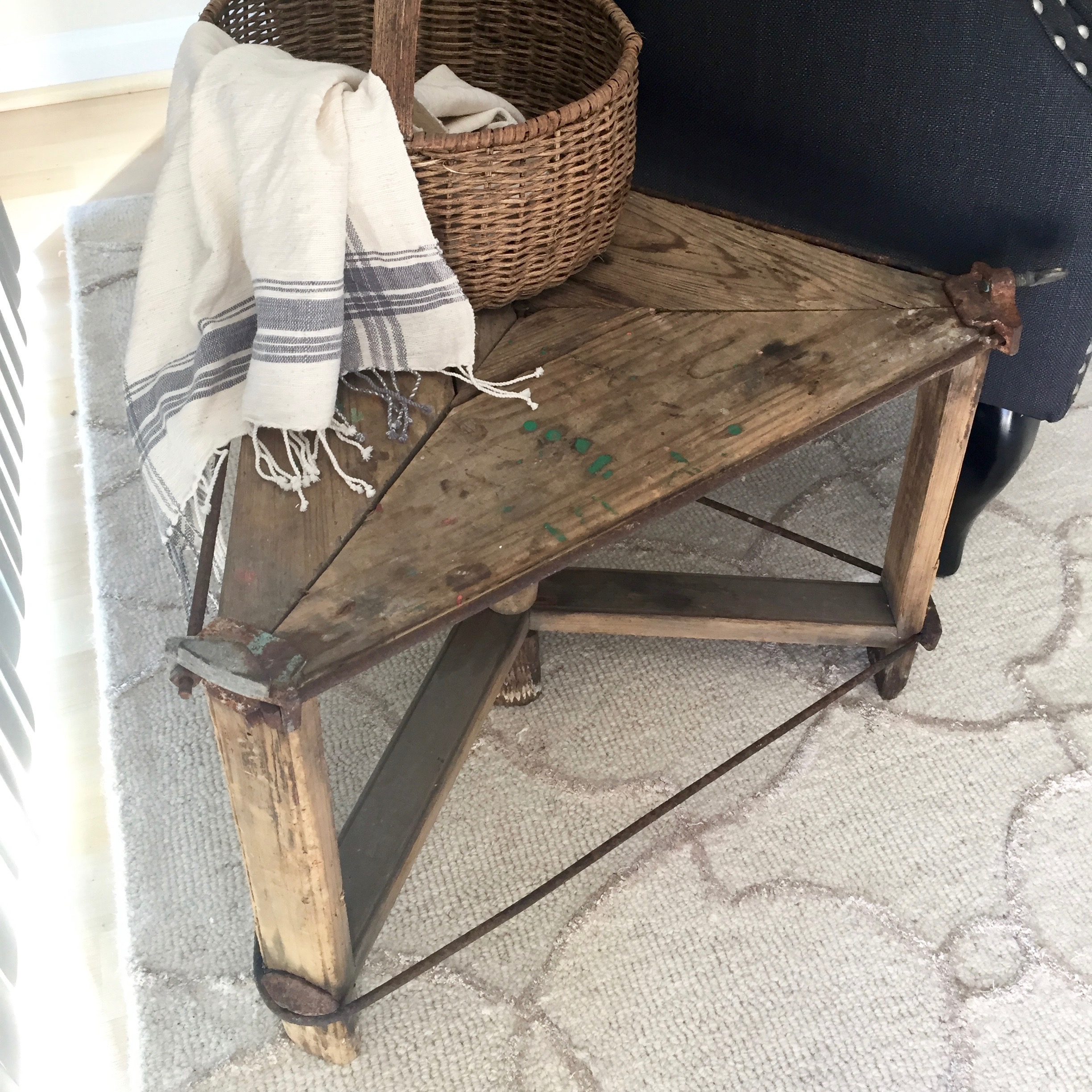 Branch out from traditionally side tables with unusual options, like this washtub stand.